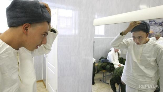 Киевлян запугивают «похоронными» вывесками на дверях военкоматов