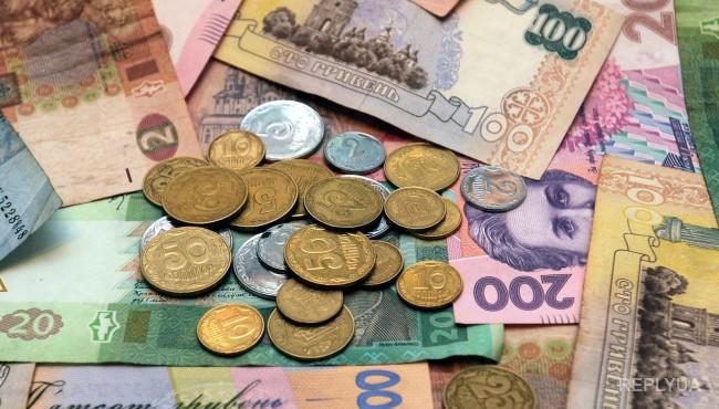 Нацбанк понизил курс гривны
