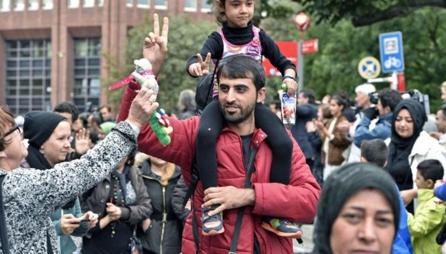 В Германию прибыли почти 1 миллион 300 тысяч мигрантов