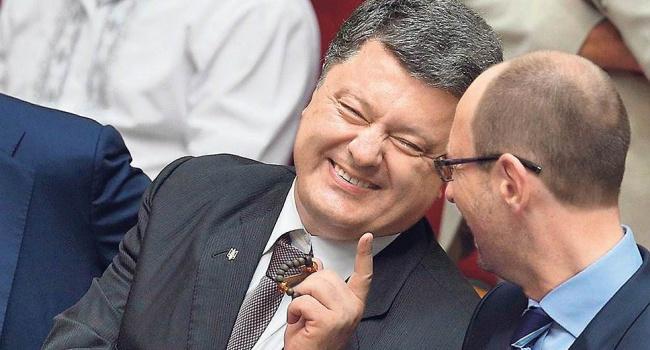 Политолог рассказал, что думают на Западе о Яценюке и Порошенко