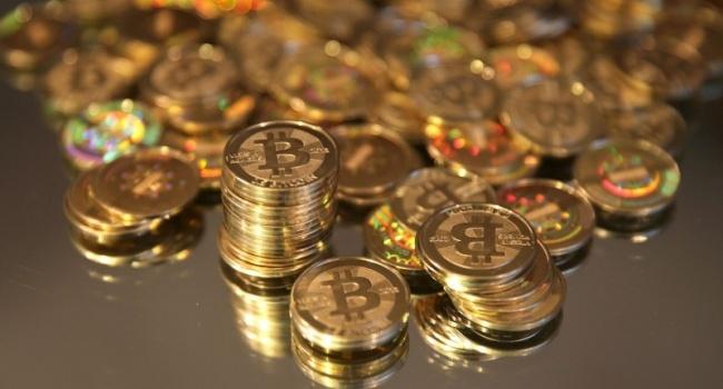 Курс биткоина упал практически на30% наименее чем занеделю