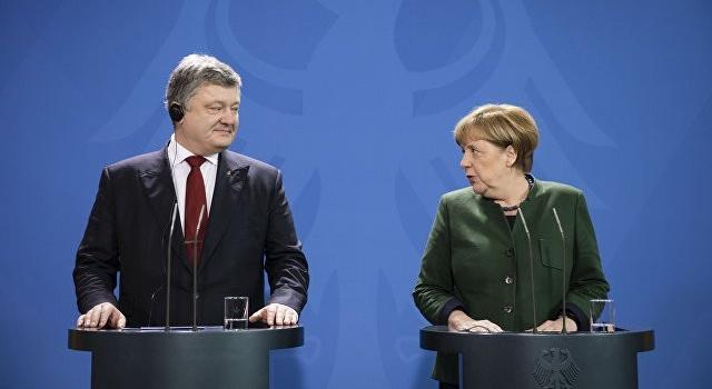 В России увидели символичность в поездке Порошенко в Германию 9 мая