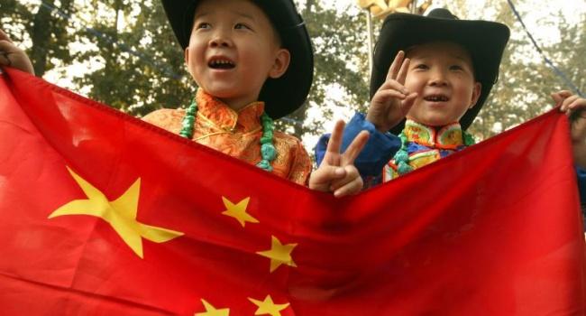 Власти Китая намерены снять ограничения по рождаемости