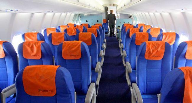 Эксперты рассказали о самых безопасных местах в самолете
