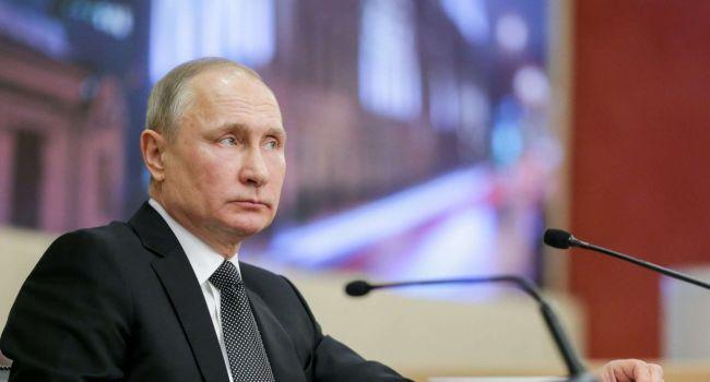 Путин обсудил ситуацию в Украине с Макроном и Меркель