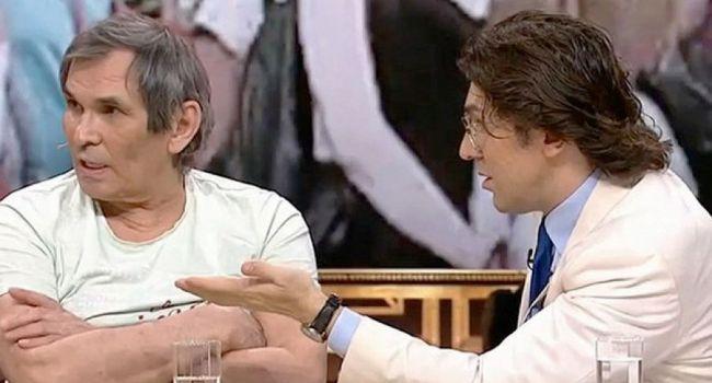 Мастер эпатажа: мнимый больной Алибасов устроил шоу на инвалидной коляске и плюнул в лицо Малахову