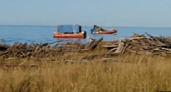«Вот она, смерть»: местные жители Ненокса обнародовали снимки с места взрыва ракеты