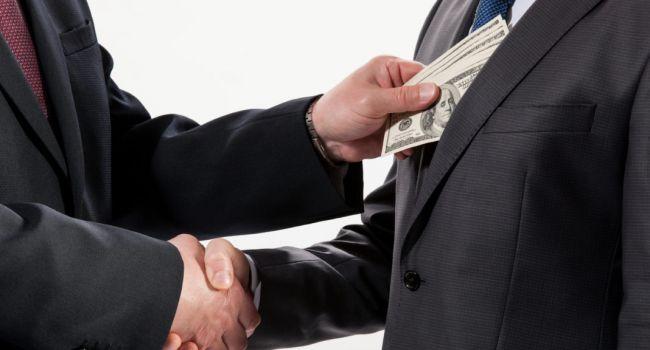 «В Украине начнется поощрение доносов»: Политолог прокомментировал законопроект о вознаграждении обличителей коррупции