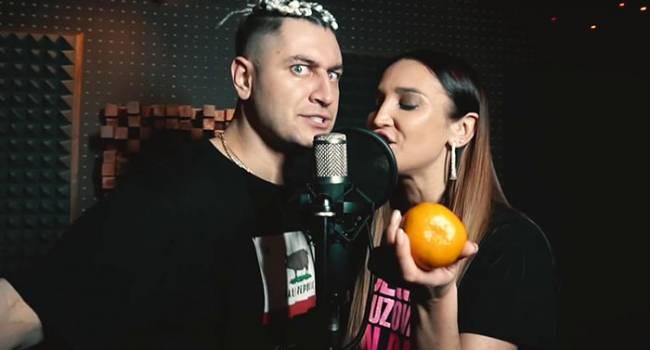 «Два д*била с одним уровнем «таланта»»: Олю Бузову и Даву раскритиковали за видео на песню «Мандаринка»