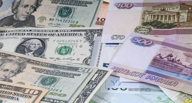 Выше 100 рублей за доллар: аналитики прогнозируют девальвацию российской валюты