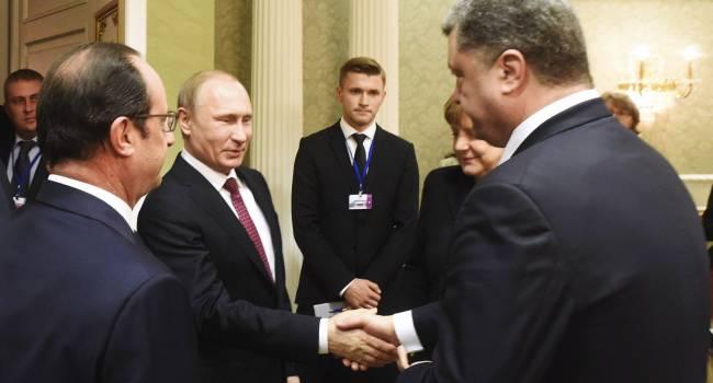 «Не только поздравил, но и стал президентом по доброй воле России»: депутат прокомментировал новость о том, как Порошенко поздравил Путина с Днем России