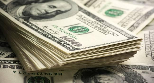 Авторитетное британское издание прогнозирует рекордное падение стоимости доллара