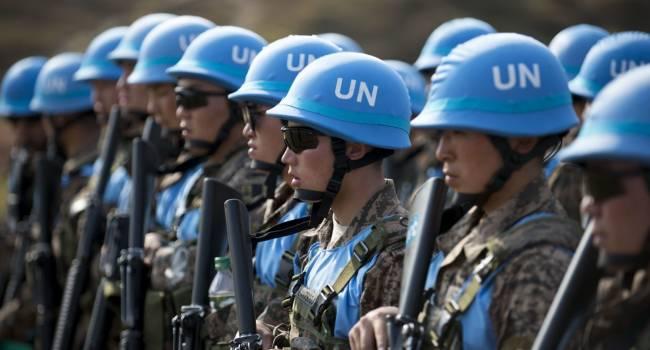 На данном этапе российской агрессии против Украины говорить о введении миротворческого контингента преждевременно - мнение