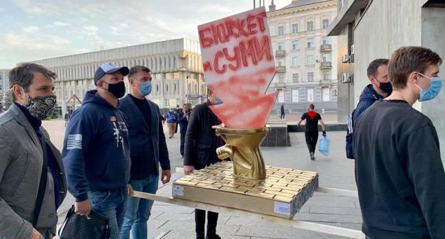 В Сумах мэру Лысенко подарили «золотой унитаз», куда он неразумно смывает городской бюджет, наплевав на коронавирус