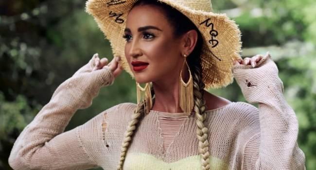 «Нереальная красотка»: Ольга Бузова сразила наповал своим новым образом, позируя в белом костюме